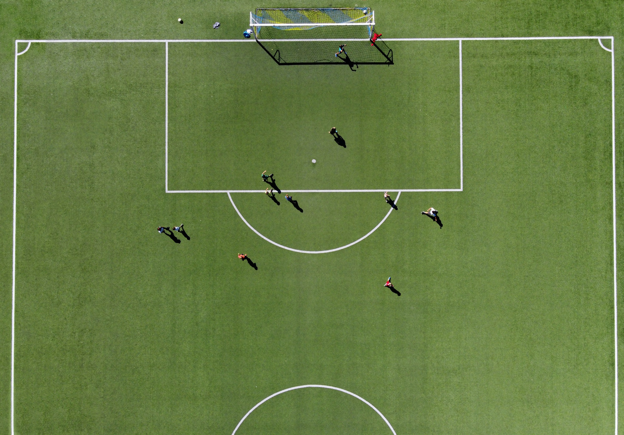 Soccer players on a green sports field